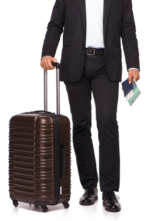 lower section: Lower section of businessman with luggage, passport and tickets Stock Photo