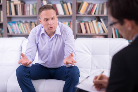 Portrait of a Man talking to his psychologist