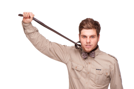 stifle: Young man trying to stifle himself with belt, isolated on white. Concept for work annoyance Stock Photo