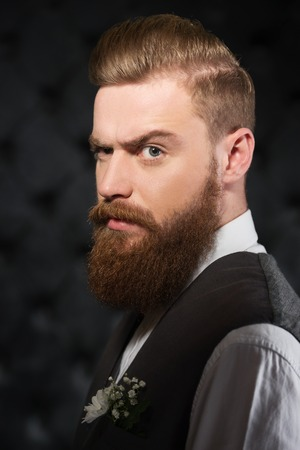 aucasian: Portrait of serious man with beard and severe look. Concept for modern hipster Stock Photo