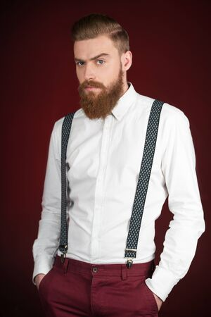 Image of stylish casual modern man with beard looking at camera