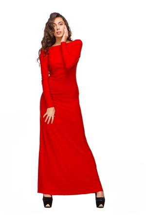 aucasian: Stunning young woman with curly hair wearing lovely red dress, isolated on white background Stock Photo