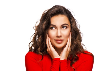 aucasian: Close up portrait of gorgeous woman looking aside with curly hair in red dress, isolated on white background