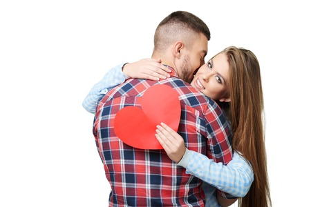aucasian: Happy young Caucasian couple having romantic time together. Man hugging and kissing woman. Beautiful woman looking at camera. Concept for Valentines Day