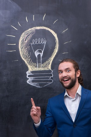 charismatic: Charismatic handsome man have a bright idea Stock Photo