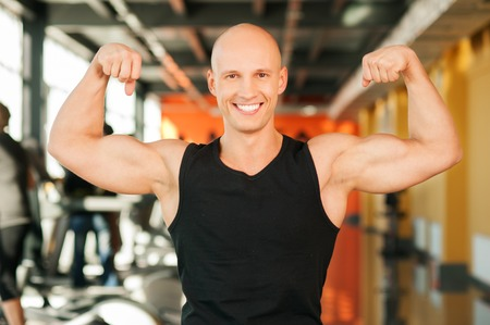 25 29: Handsome young muscular sports man at the gym Stock Photo