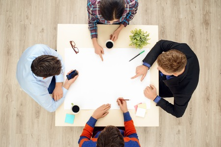 aucasian: Top view of table with group of creative people working on project. Business team concept Stock Photo