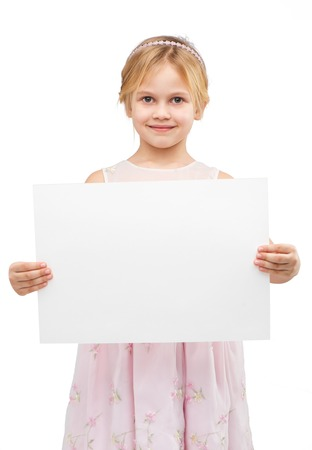 �aucasian: Little girl wearing pink dress, standing isolated on white background and holding white blank paper