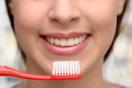 aucasian: Close up photo of female patient with toothbrush at dentist office. Concept for teeth hygiene Stock Photo