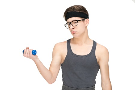 Funny sporty nerd in glasses and dumbbell isolated on white background