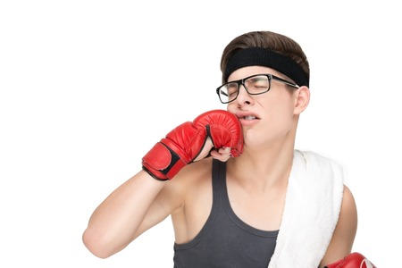 Young man hit himself in the face boxing glove. Man hit himself in the face Stock Photo