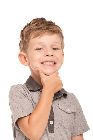 cheerfully: Cute little boy is isolated on white background. Boy looking at camera and cheerfully smiling