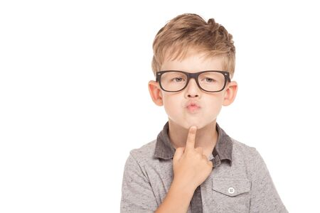 looking aside: Cute little boy is isolated on white background. Boy wearing glasses, looking aside pompously and thoughtfully