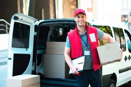 shipping package: Colorful picture of courier delivers package. Courier holding the box and smiling.