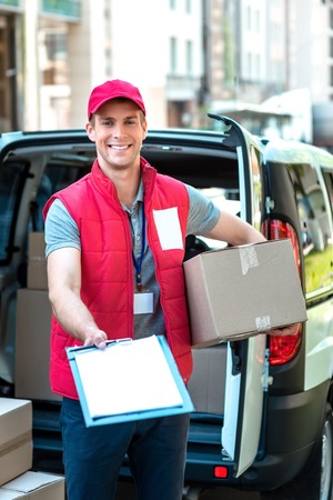 delivers: Colorful picture of courier delivers package. Courier giving the dokument for sign.
