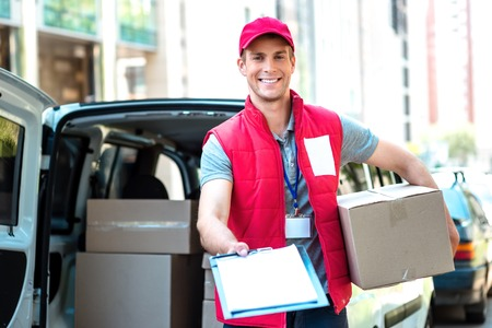 delivery person: Colorful picture of courier delivers package. Courier giving the dokument for sign.