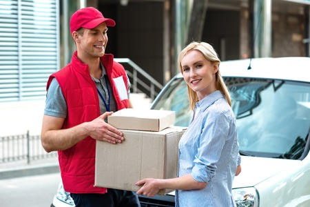 accepts: Colorful picture of courier delivers package for woman. Courier is giving the woman a box. Woman accepts the parcel.