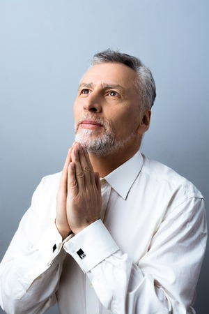concetrated: Portrait of concetrated old man praying to God and looking up