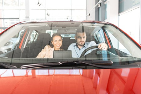 concept car: Photo of young couple sitting inside new car. Concept for car rental Stock Photo