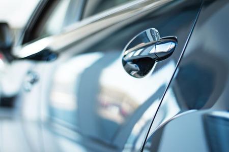 Close up photo of new car door. Concept for car rental