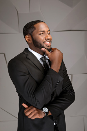 Portrait of handsome afro american businessman. Young stylish businessman smiling. Man wearing suit and tie