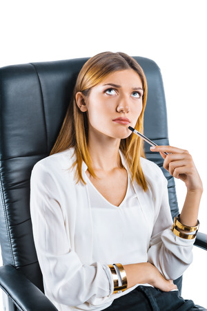 bossy: Portrait of young businesswoman in bossy chair. Businesswoman on white background thoughtfully looking up Stock Photo