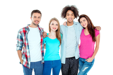 multicultural: Studio shot of nice young multicultural friends. Beautiful people looking at camera, hugging and smiling. Isolated background Stock Photo