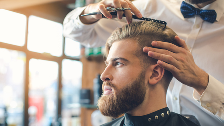 comb: Young Man in Barbershop Hair Care Service Concept