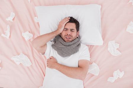 Sick young man headache concept Imagens