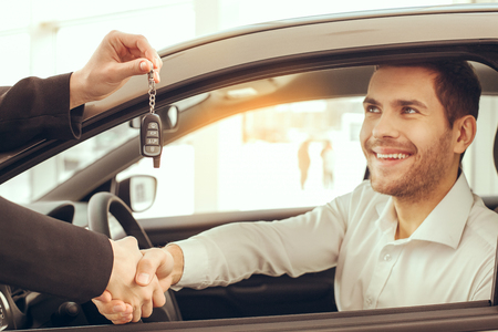 Young Man in a Car Rental Service Test Drive Concept Stock Photo