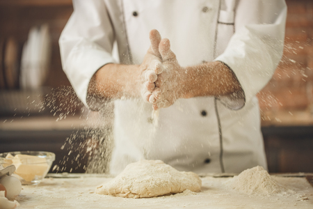 Bakery chef cooking bake in the kitchen professional