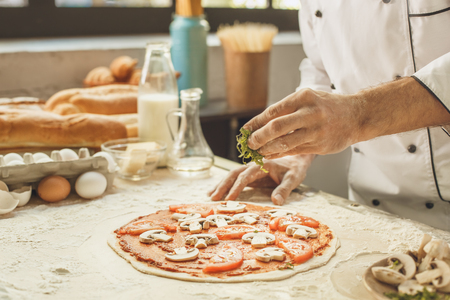 pizza base: Bakery chef cooking bake in the kitchen professional