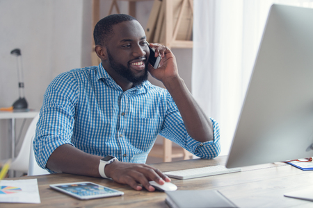 Young african man working in the office business