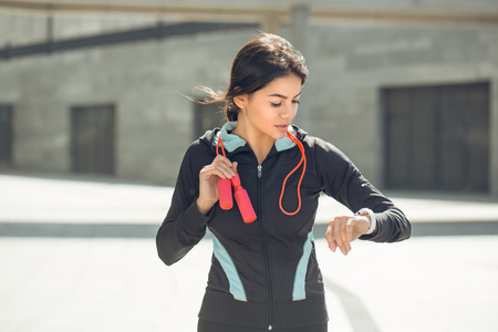 Young woman active exercise workout on street outdoor