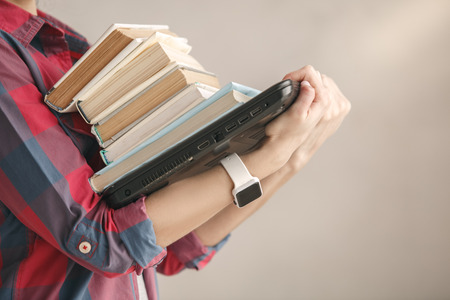 Young woman with books studio portrait education