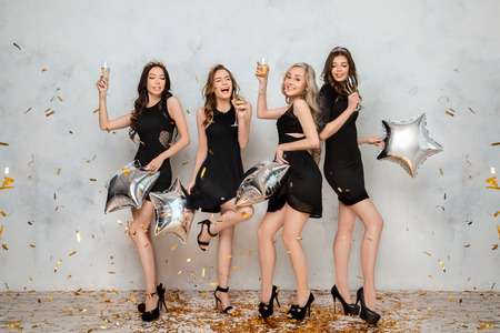 Young women together celebrating hen party isolated on white Standard-Bild