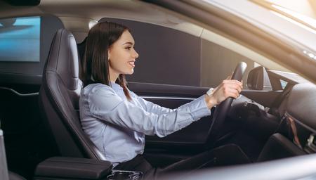 Woman transportation by modern eco car steering wheel