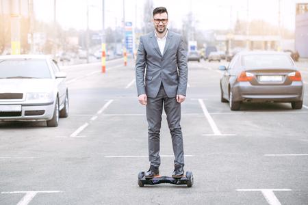 Man driving modern mode of transport riding