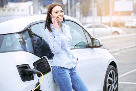 Woman transportation by modern eco car phone call