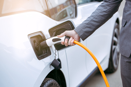 Man transportation by modern eco car charge energy Stock Photo