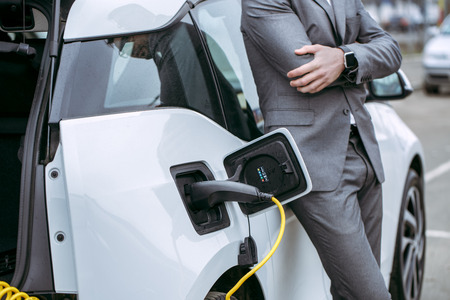 Man transportation by modern eco car charge energy Banque d'images