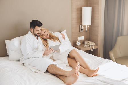 Young man and woman together tourism hotel using digital device