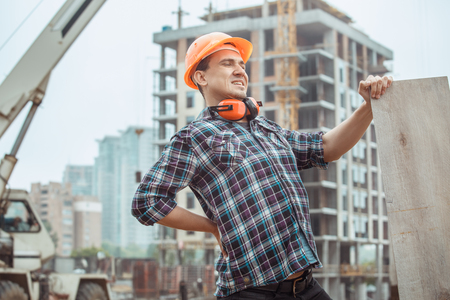 Male work building construction engineering occupation holding wooden board