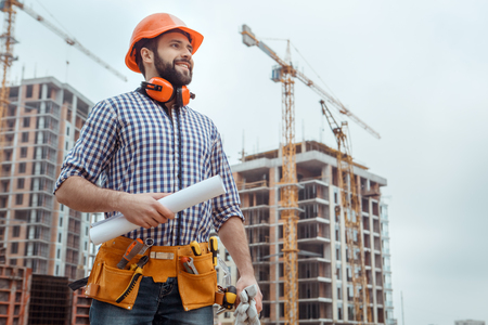 Male work building construction engineering occupation holding blueprint Archivio Fotografico