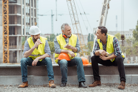 Male work building construction engineering occupation eating sandwiches