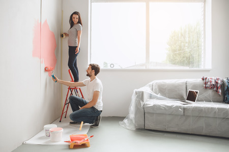 Young couple doing apartment repair together themselves Archivio Fotografico
