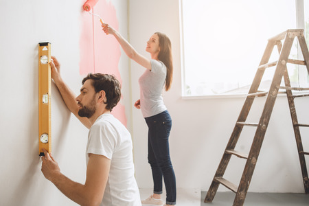 Young couple doing apartment repair together themselves Stock Photo