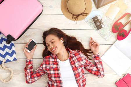 Young woman traveler tourist top view vacation Reklamní fotografie