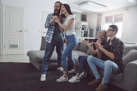 Group of friends having party together at home