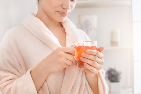 Young woman body care at home indoors Standard-Bild
